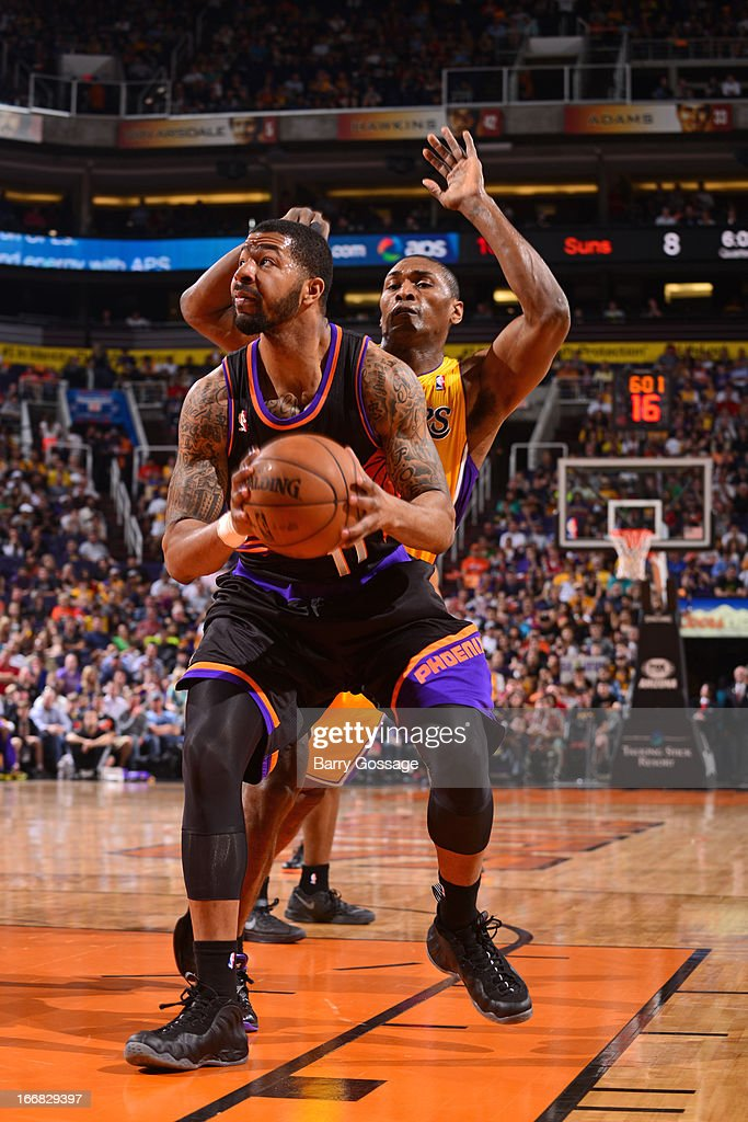 <a gi-track='captionPersonalityLinkClicked' href=/galleries/search?phrase=Markieff+Morris&family=editorial&specificpeople=5293881 ng-click='$event.stopPropagation()'>Markieff Morris</a> #11 of the Phoenix Suns goes up for the easy basket against the Los Angeles Lakers on March 18, 2013 at U.S. Airways Center in Phoenix, Arizona.
