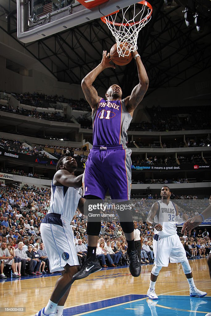 Markieff Morris #11 of the Phoenix Suns grabs a rebound against Jae Crowder #9 of the Dallas Mavericks on October 17, 2012 at the American Airlines Center in Dallas, Texas.