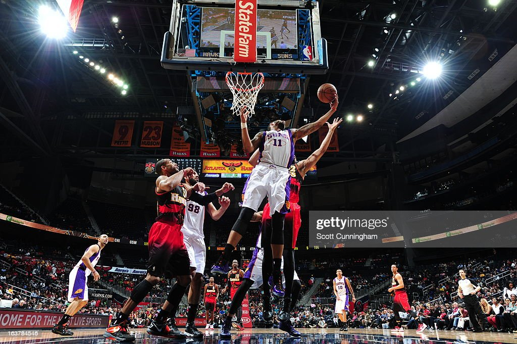 Markieff Morris #11 of the Phoenix Suns grabs the rebound against the Atlanta Hawks on March 15, 2013 at Philips Arena in Atlanta, Georgia.