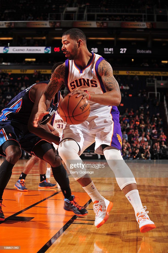<a gi-track='captionPersonalityLinkClicked' href=/galleries/search?phrase=Markieff+Morris&family=editorial&specificpeople=5293881 ng-click='$event.stopPropagation()'>Markieff Morris</a> #11 of the Phoenix Suns handles the ball against <a gi-track='captionPersonalityLinkClicked' href=/galleries/search?phrase=Michael+Kidd-Gilchrist&family=editorial&specificpeople=8526214 ng-click='$event.stopPropagation()'>Michael Kidd-Gilchrist</a> #14 of the Charlotte Bobcats on December 19, 2012 at U.S. Airways Center in Phoenix, Arizona.