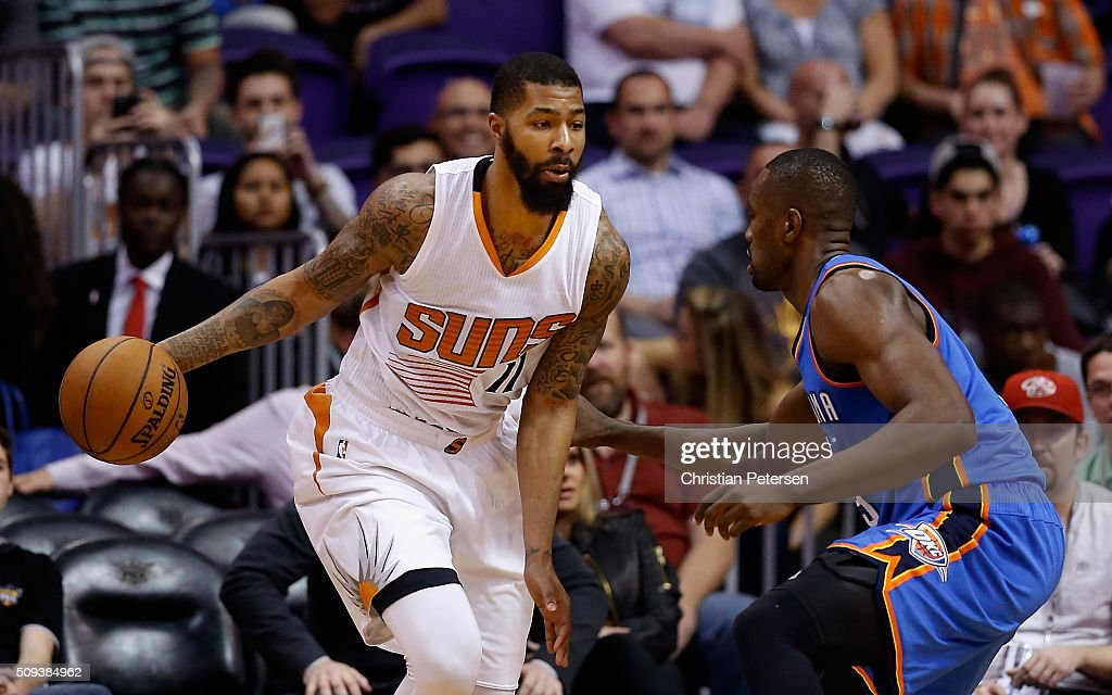Markieff Morris of the Phoenix Suns handles the ball against Serge Ibaka of the Oklahoma City Thunder during the NBA game at Talking Stick Resort...