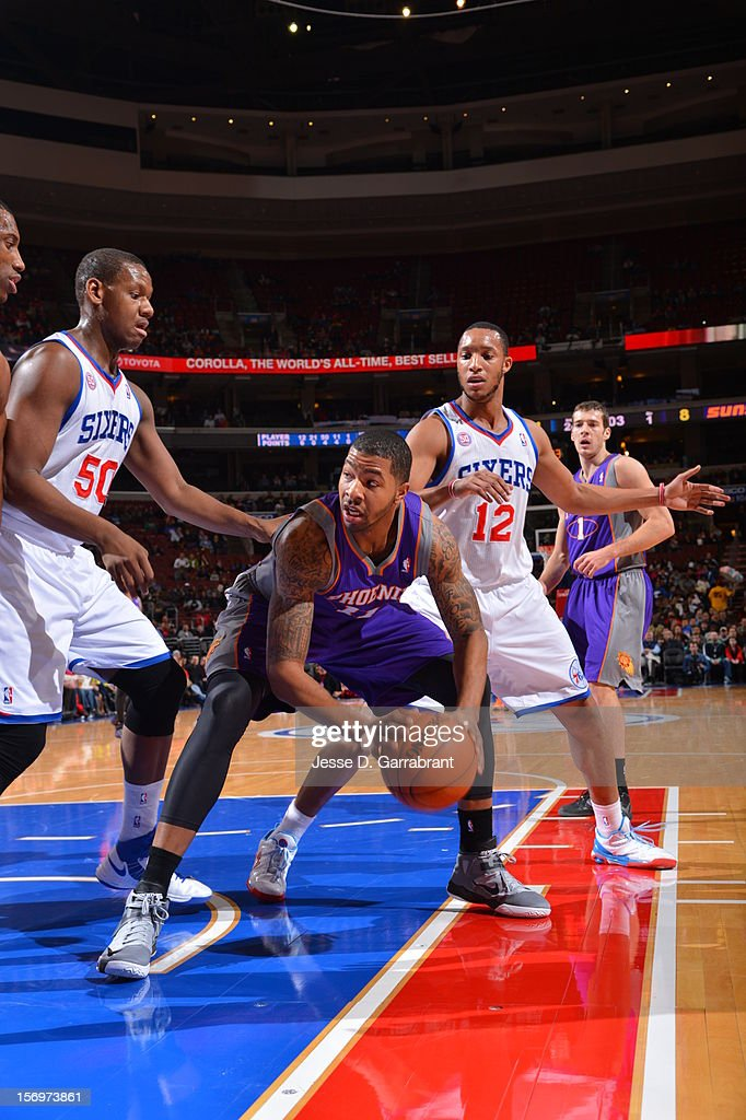 Markieff Morris #11 of the Phoenix Suns looks to make a move against Lavoy Allen #50 of the Philadelphia 76ers at the Wells Fargo Center on November 25, 2012 in Philadelphia, Pennsylvania.