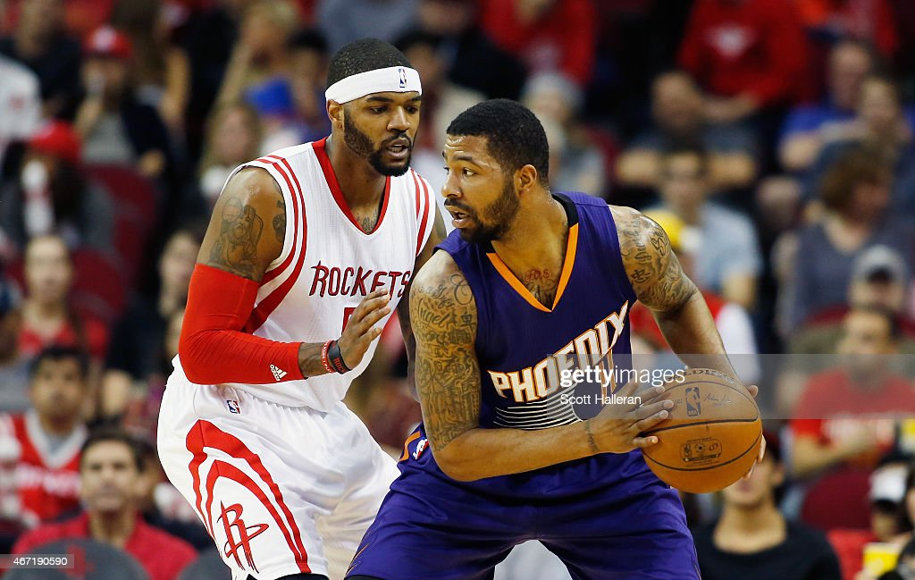 Markieff Morris of the Phoenix Suns looks to pass the basketball as Josh Smith of the Houston Rockets defends during their game at the Toyota Center...