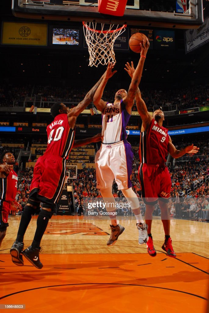 Markieff Morris #11 of the Phoenix Suns puts a shot up between Udonis Haslem #40 and Rashard Lewis #9 of the Miami Heat on November 17, 2012 at U.S. Airways Center in Phoenix, Arizona.