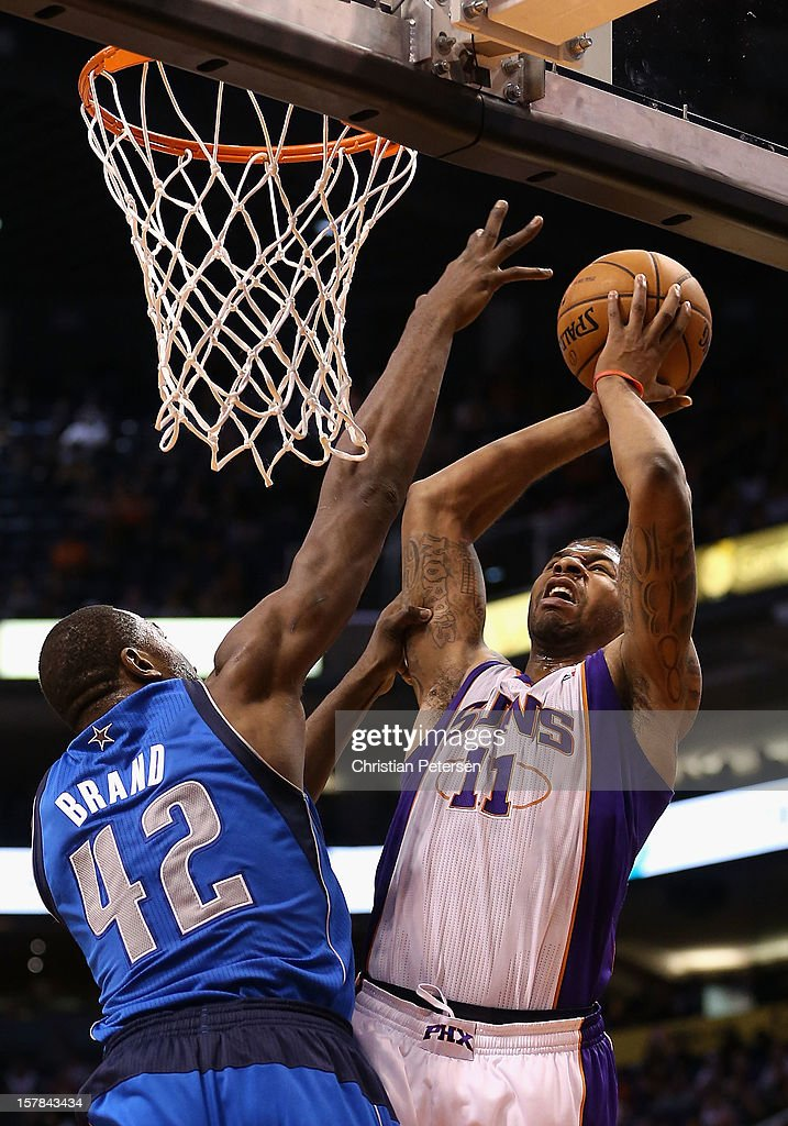 <a gi-track='captionPersonalityLinkClicked' href=/galleries/search?phrase=Markieff+Morris&family=editorial&specificpeople=5293881 ng-click='$event.stopPropagation()'>Markieff Morris</a> #11 of the Phoenix Suns puts up a shot over Elton Brand #42 of the Dallas Mavericks during the NBA game at US Airways Center on December 6, 2012 in Phoenix, Arizona. The Mavericks defeated the Suns 97-94.