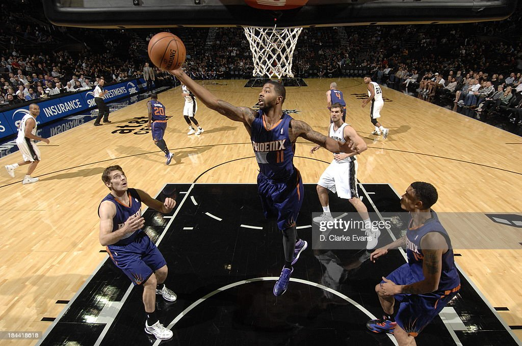 <a gi-track='captionPersonalityLinkClicked' href=/galleries/search?phrase=Markieff+Morris&family=editorial&specificpeople=5293881 ng-click='$event.stopPropagation()'>Markieff Morris</a> #11 of the Phoenix Suns puts up the shot against the San Antonio Spurs during the preseason at the AT&T Center on October 13, 2013 in San Antonio, Texas.