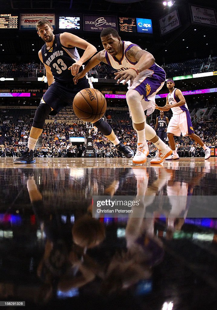 <a gi-track='captionPersonalityLinkClicked' href=/galleries/search?phrase=Markieff+Morris&family=editorial&specificpeople=5293881 ng-click='$event.stopPropagation()'>Markieff Morris</a> #11 of the Phoenix Suns reaches for a loose ball under pressure from <a gi-track='captionPersonalityLinkClicked' href=/galleries/search?phrase=Marc+Gasol&family=editorial&specificpeople=661205 ng-click='$event.stopPropagation()'>Marc Gasol</a> #33 of the Memphis Grizzlies during the NBA game at US Airways Center on December 12, 2012 in Phoenix, Arizona. The Suns defeated the Grizzlies 82-80.