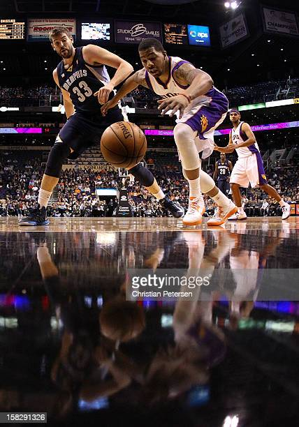 Markieff Morris of the Phoenix Suns reaches for a loose ball under pressure from Marc Gasol of the Memphis Grizzlies during the NBA game at US...