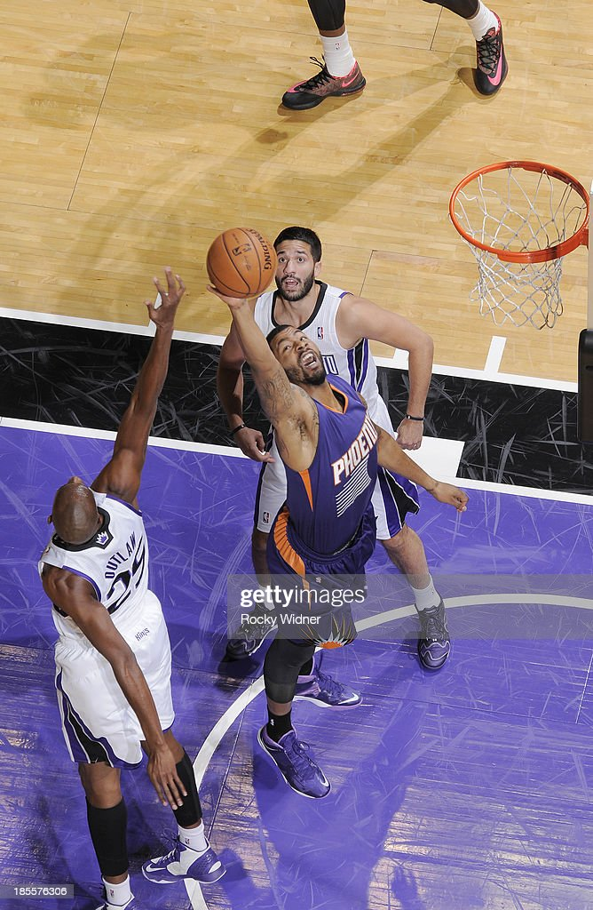 <a gi-track='captionPersonalityLinkClicked' href=/galleries/search?phrase=Markieff+Morris&family=editorial&specificpeople=5293881 ng-click='$event.stopPropagation()'>Markieff Morris</a> #11 of the Phoenix Suns rebounds against <a gi-track='captionPersonalityLinkClicked' href=/galleries/search?phrase=Travis+Outlaw&family=editorial&specificpeople=203322 ng-click='$event.stopPropagation()'>Travis Outlaw</a> #25 of the Sacramento Kings on October 17, 2013 at Sleep Train Arena in Sacramento, California.