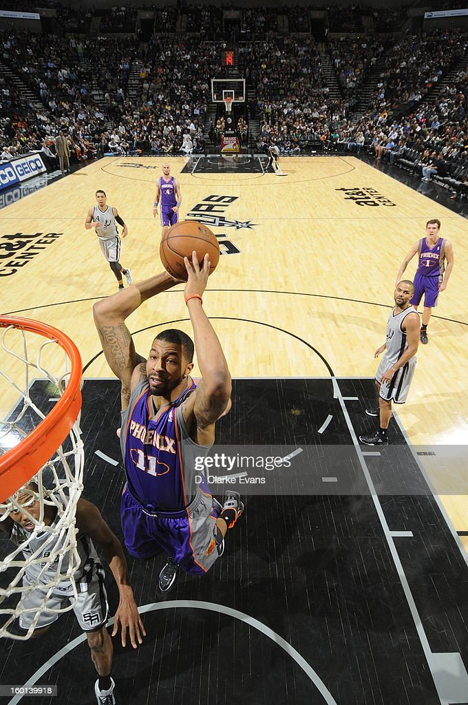 Markieff Morris #11 of the Phoenix Suns rises for a dunk against the San Antonio Spurs on January 26, 2013 at the AT&T Center in San Antonio, Texas.