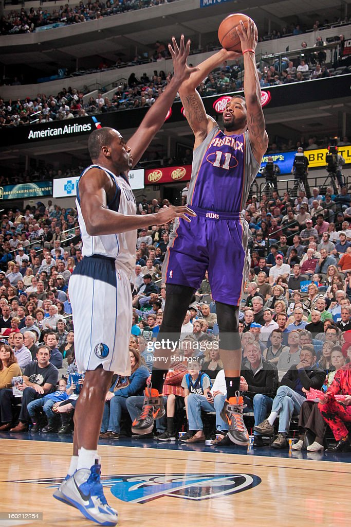 Markieff Morris #11 of the Phoenix Suns shoots against Elton Brand #42 of the Dallas Mavericks on January 27, 2013 at the American Airlines Center in Dallas, Texas.