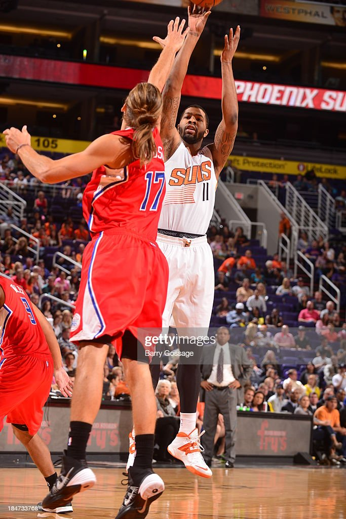 <a gi-track='captionPersonalityLinkClicked' href=/galleries/search?phrase=Markieff+Morris&family=editorial&specificpeople=5293881 ng-click='$event.stopPropagation()'>Markieff Morris</a> #11 of the Phoenix Suns shoots against Lou Amundson #17 of the Los Angeles Clipper on October 15, 2013 at U.S. Airways Center in Phoenix, Arizona.