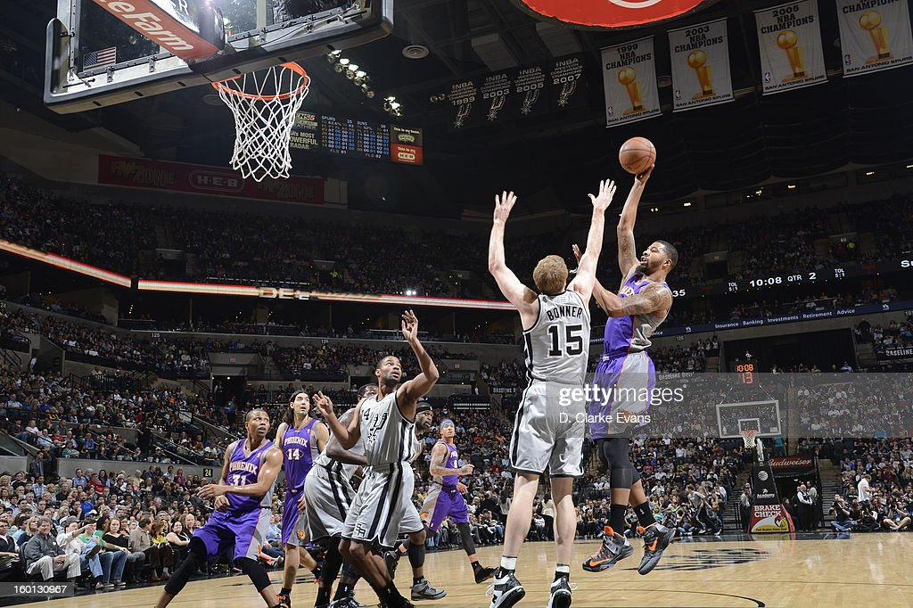 Markieff Morris #11 of the Phoenix Suns shoots against Matt Bonner #15 of the San Antonio Spurs on January 26, 2013 at the AT&T Center in San Antonio, Texas.