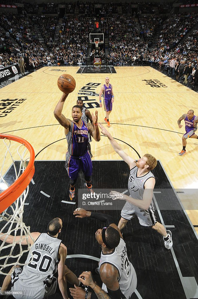 <a gi-track='captionPersonalityLinkClicked' href=/galleries/search?phrase=Markieff+Morris&family=editorial&specificpeople=5293881 ng-click='$event.stopPropagation()'>Markieff Morris</a> #11 of the Phoenix Suns shoots against <a gi-track='captionPersonalityLinkClicked' href=/galleries/search?phrase=Matt+Bonner&family=editorial&specificpeople=203054 ng-click='$event.stopPropagation()'>Matt Bonner</a> #15 of the San Antonio Spurs on January 26, 2013 at the AT&T Center in San Antonio, Texas.