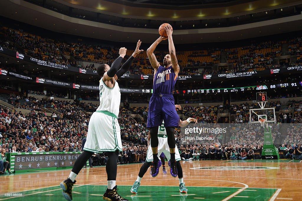 Markieff Morris of the Phoenix Suns shoots against the Boston Celticsduring the game on November 17 2014 at TD Garden in Boston Massachusetts NOTE...