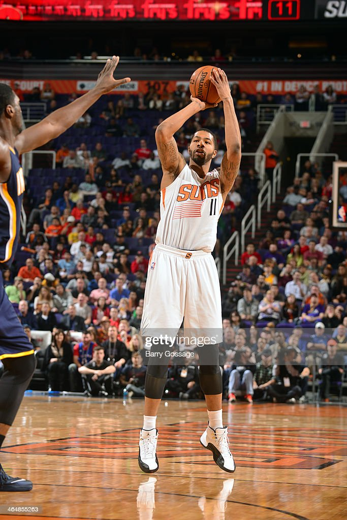 <a gi-track='captionPersonalityLinkClicked' href=/galleries/search?phrase=Markieff+Morris&family=editorial&specificpeople=5293881 ng-click='$event.stopPropagation()'>Markieff Morris</a> #11 of the Phoenix Suns shoots against the Indiana Pacers on January 22, 2014 at U.S. Airways Center in Phoenix, Arizona.