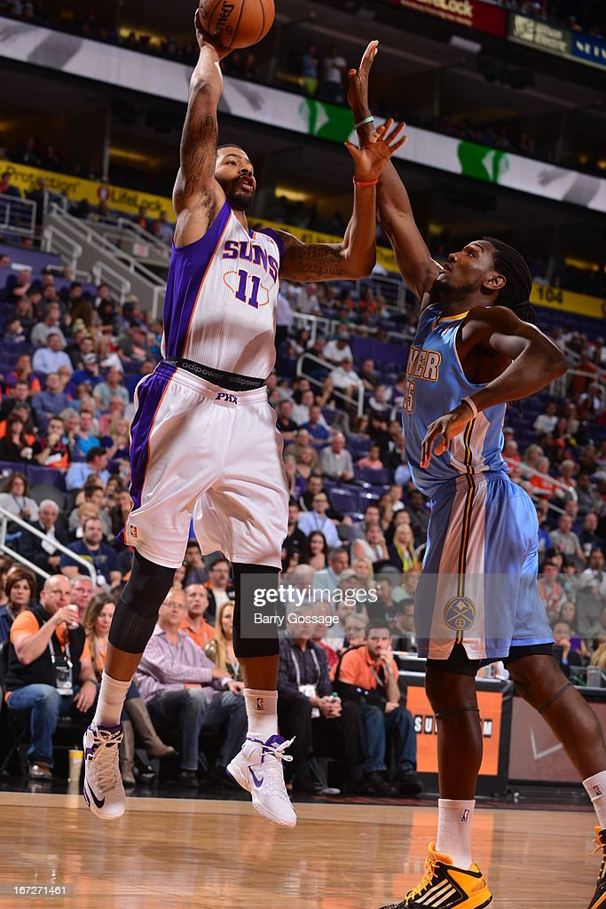 <a gi-track='captionPersonalityLinkClicked' href=/galleries/search?phrase=Markieff+Morris&family=editorial&specificpeople=5293881 ng-click='$event.stopPropagation()'>Markieff Morris</a> #11 of the Phoenix Suns shoots the bal against the Denver Nuggets on March 11, 2013 at U.S. Airways Center in Phoenix, Arizona.