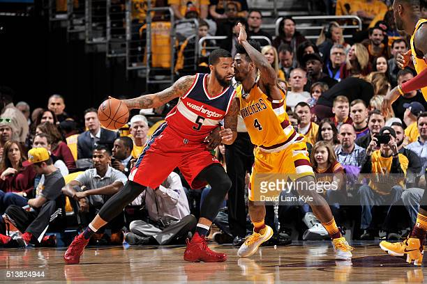 Markieff Morris of the Washington Wizards handles the ball during the game against Iman Shumpert of the Cleveland Cavaliers on March 4 2016 at...