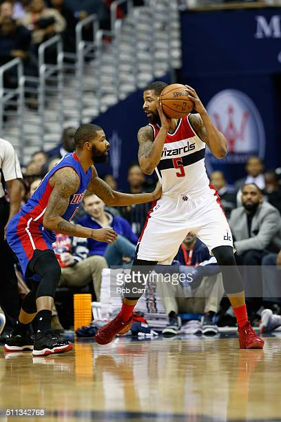 Markieff Morris of the Washington Wizards looks to dribble against his twin brother Marcus Morris of the Detroit Pistons in the first half at Verizon...