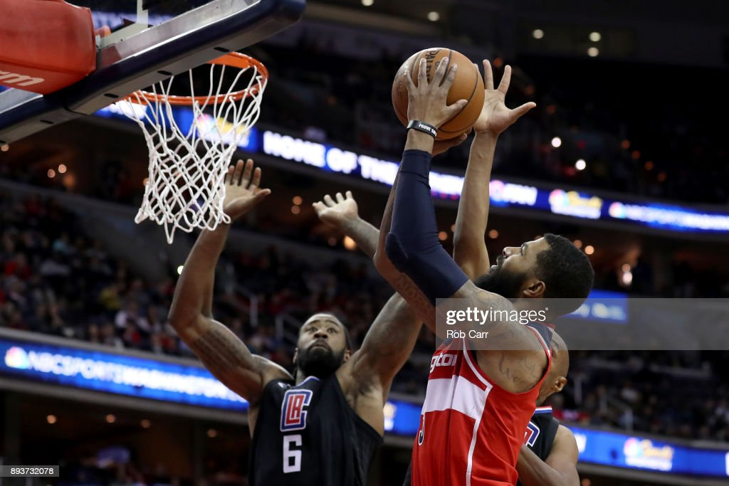 Markieff Morris #5 of the Washington Wizards puts up a shot in front of DeAndre Jordan #6 of the LA Clippers in the second half at Capital One Arena on December 15, 2017 in Washington, DC.