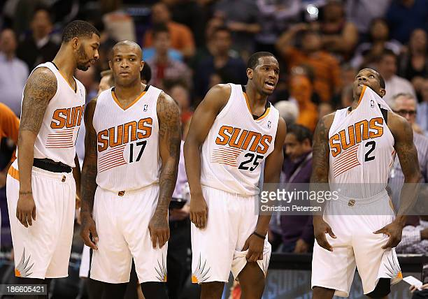 Markieff Morris PJ Tucker Dionte Christmas and Eric Bledsoe of the Phoenix Suns wait for a official review during the final moments of the NBA game...