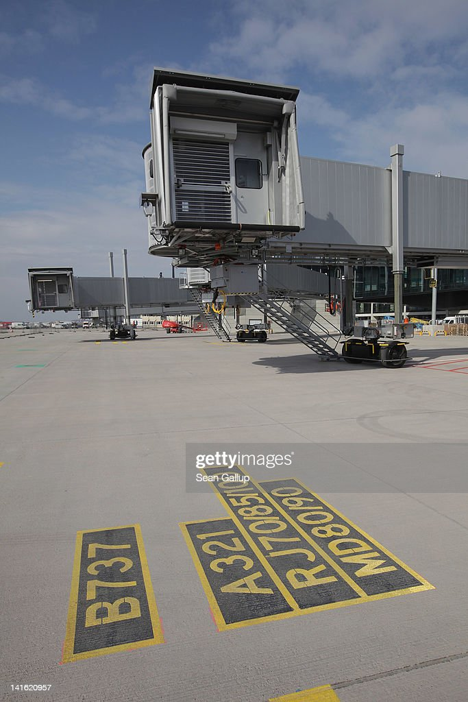 Markings show a gate suited for Boeing 737 and Airbus A318-320 passenger planes next to jetways on the tarmac at Willy Brandt Berlin Brandenburg International Airport on March 20, 2012 in Berlin, Germany. The new airport, which will replace the city's current Tegel and Schoenefeld airports, will officially open in May and begin operation on June 3.