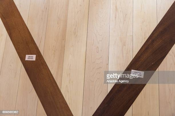 Markings showing where US Secretary of State Rex Tillerson and UK Secretary of Foreign Affairs Boris Johnson would stand on the floor are seen after...