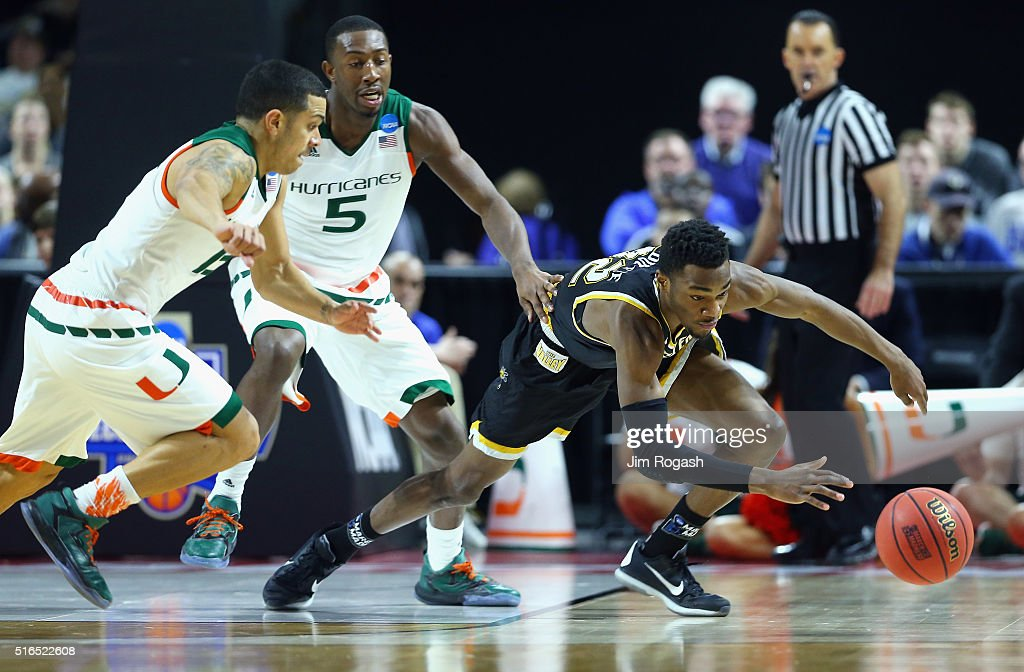 Markis McDuffie of the Wichita State Shockers battles for the loose ball with Angel Rodriguez of the Miami Hurricanes and Davon Reed in the first...