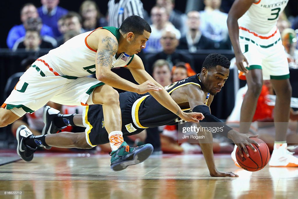 Markis McDuffie of the Wichita State Shockers battles for the loose ball with Angel Rodriguez of the Miami Hurricanes in the first half of their game...