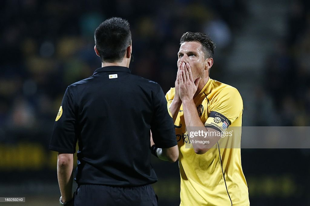 Mark-Jan Fledderus of Roda JC (R), Referee Dennis Higler (L) during the Dutch Eredivisie match between Roda JC Kerkrade and PEC Zwolle at the Parkstad Limburg on Oktober 5, 2013 in Kerkrade, The Netherlands
