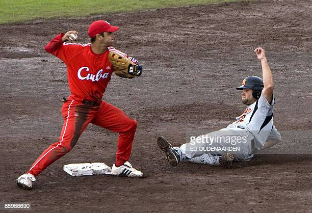 MarkJan Moorman of The Netherlands is out on second base during the final of the World Port baseball Tournament 2009 in Rotterdam July 12 2009 Cuban...