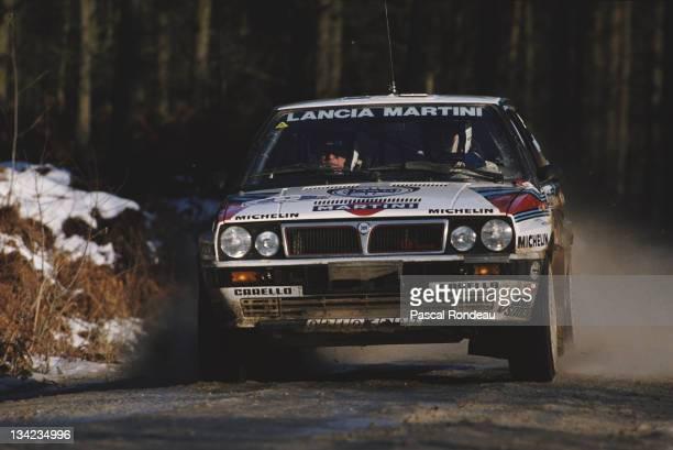 Markku Alen and co driver navigator Ilkka Kivimaki of Finland driving the Martini Lancia Delta Integrale duringthe FIA World Rally Championship 44th...