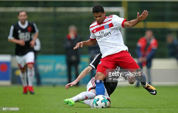 MarkMichael Voelker of Rotenburg and Douglas Santos of Hamburg battle for the balll during the preseason friendly match between Rotenburger SV and...