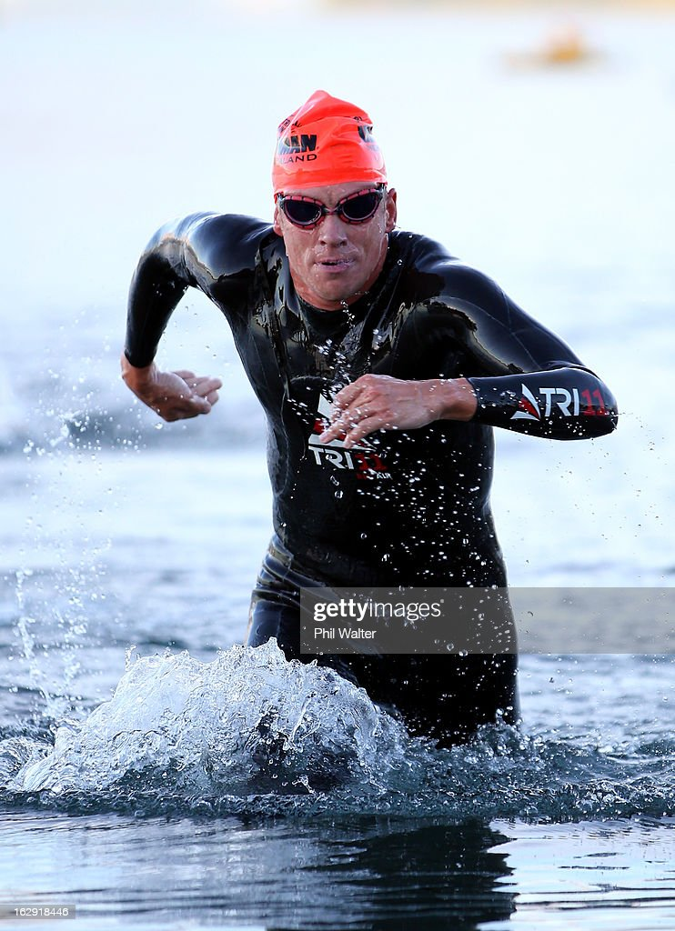 Marko Albert of Estonia leaves the water after the swim leg during the New Zealand Ironman on March 2, 2013 in Taupo, New Zealand.