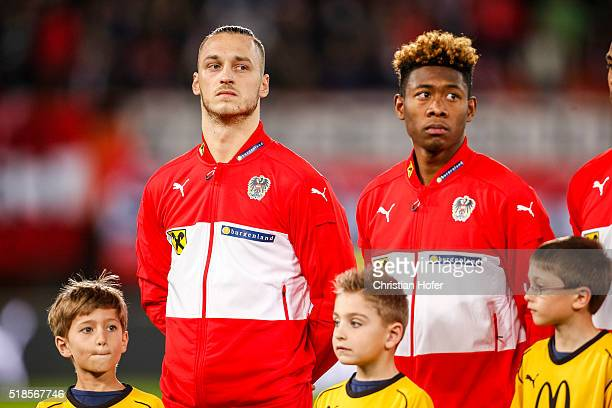 Marko Arnautovic and David Alaba of Austria line up during the national anthem prior to the international friendly match between Austria and Turkey...