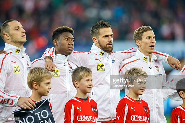 Marko Arnautovic David Alaba Martin Harnik and Florian Klein of Austria line up during the national anthem prior to the UEFA EURO 2016 Qualifier...