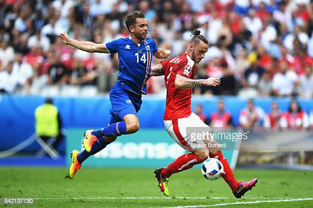 Marko Arnautovic of Austria holds off the challenge of Kari Arnason of Iceland during the UEFA EURO 2016 Group F match between Iceland and Austria at...