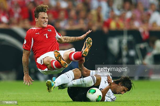 Marko Arnautovic of Austria is challenged by Sami Khedira of Germany during the FIFA 2014 World Cup Group C qualifying match between Germany and...
