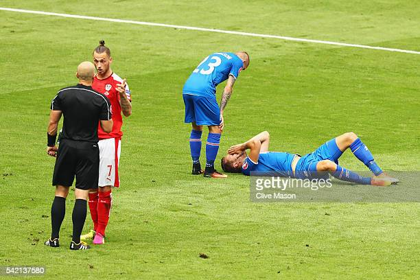 Marko Arnautovic of Austria receives a lecture from the referee after a challenge on Kari Arnason of Iceland during the UEFA EURO 2016 Group F match...