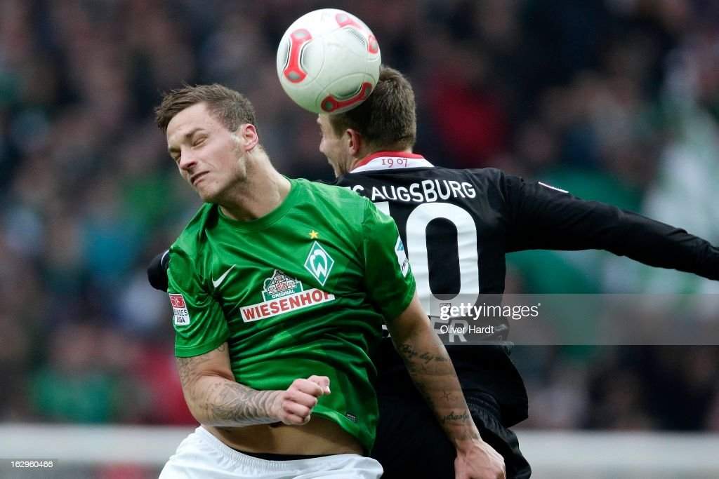 Marko Arnautovic (L) of Bremen and Daniel Baier (R) of Augsburg battle for the ball during the Bundesliga match between SV Werder Bremen and FC Augsburg at Weser Stadium on March 2, 2013 in Bremen, Germany.