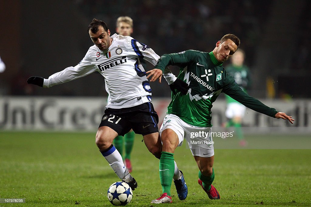 <a gi-track='captionPersonalityLinkClicked' href=/galleries/search?phrase=Marko+Arnautovic&family=editorial&specificpeople=5567995 ng-click='$event.stopPropagation()'>Marko Arnautovic</a> (R) of Bremen and <a gi-track='captionPersonalityLinkClicked' href=/galleries/search?phrase=Goran+Pandev&family=editorial&specificpeople=800427 ng-click='$event.stopPropagation()'>Goran Pandev</a> (L) of Milano compete for the ball during the UEFA Champions League group A match between SV Werder Bremen and Internazionale Milano at Weser Stadium on December 7, 2010 in Bremen, Germany.