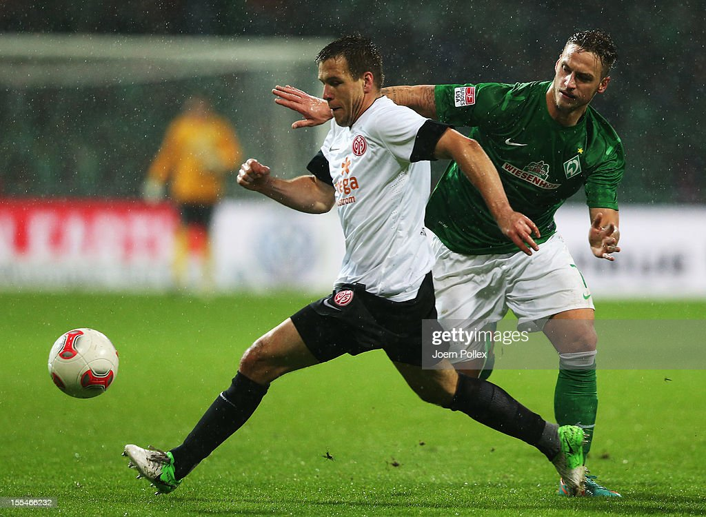 Marko Arnautovic (R) of Bremen and Nikolce Noveski of Mainz compete for the ball during the Bundesliga match between SV Werder Bremen and 1. FSV Mainz 05 at Weser Stadium on November 4, 2012 in Bremen, Germany.