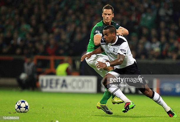 Marko Arnautovic of Bremen and Tom Huddlestone of Tottenham compete for the ball during the UEFA Champions League group A match between SV Werder...