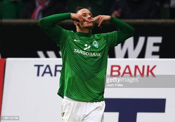 Marko Arnautovic of Bremen celebrates after scoring his team's first goal during the Bundesliga match between SV Werder Bremen and 1899 Hoffenheim at...