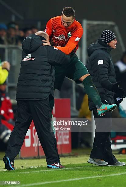 Marko Arnautovic of Bremen celebrates his team's fourth goal with head coach Thomas Schaaf during the Bundesliga match between TSG 1899 Hoffenheim...