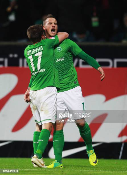 Marko Arnautovic of Bremen celebrates with his team mate Aleksandar Ignjovski after scoring his team's fourth goal during the Bundesliga match...