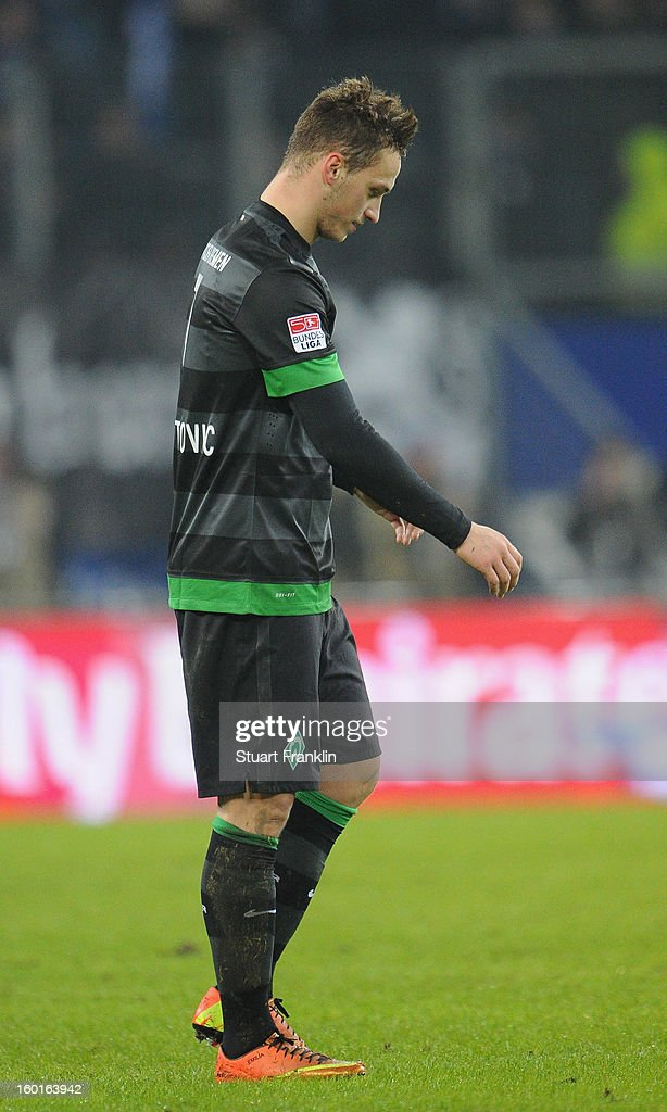 Marko Arnautovic of Bremen looks dejected after been shown double yellow cards during the Bundesliga match between Hamburger SV and SV Werder Bremen at Imtech Arena on January 27, 2013 in Hamburg, Germany.