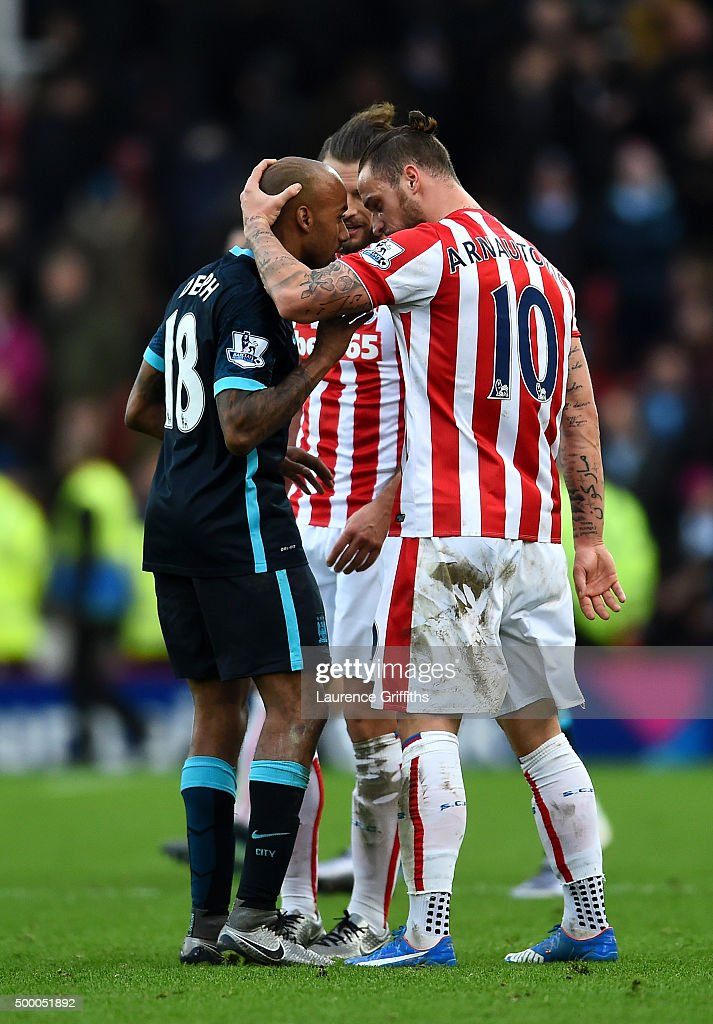 Marko Arnautovic of Stoke City and Fabian Delph of Manchester City argue after the Barclays Premier League match between Stoke City and Manchester City at Britannia Stadium on December 5, 2015 in Stoke on Trent, England.