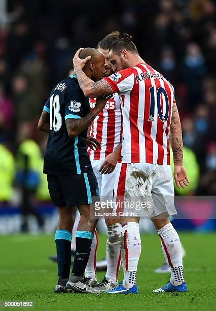 Marko Arnautovic of Stoke City and Fabian Delph of Manchester City argue after the Barclays Premier League match between Stoke City and Manchester...