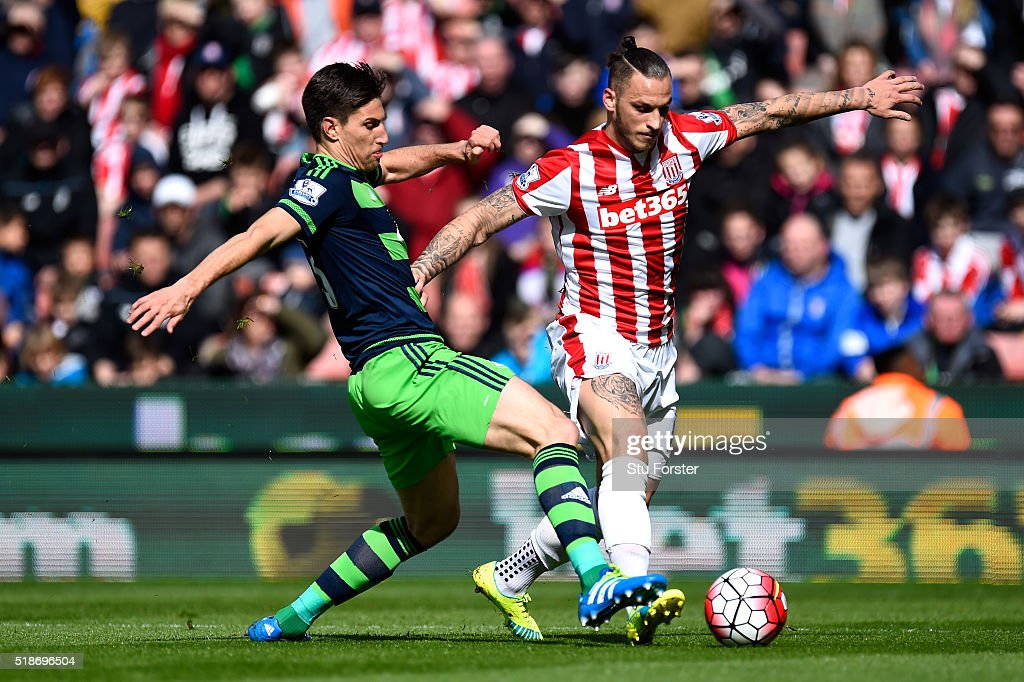 Marko Arnautovic of Stoke City and Jack Cork of Swansea City compete for the ball during the Barclays Premier League match between Stoke City and Swansea City at Britannia Stadium on April 2, 2016 in Stoke on Trent, England.
